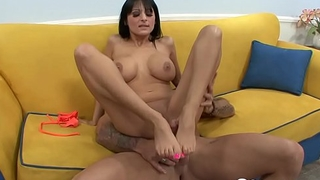Busty black-haired beauty side fucked on the couch